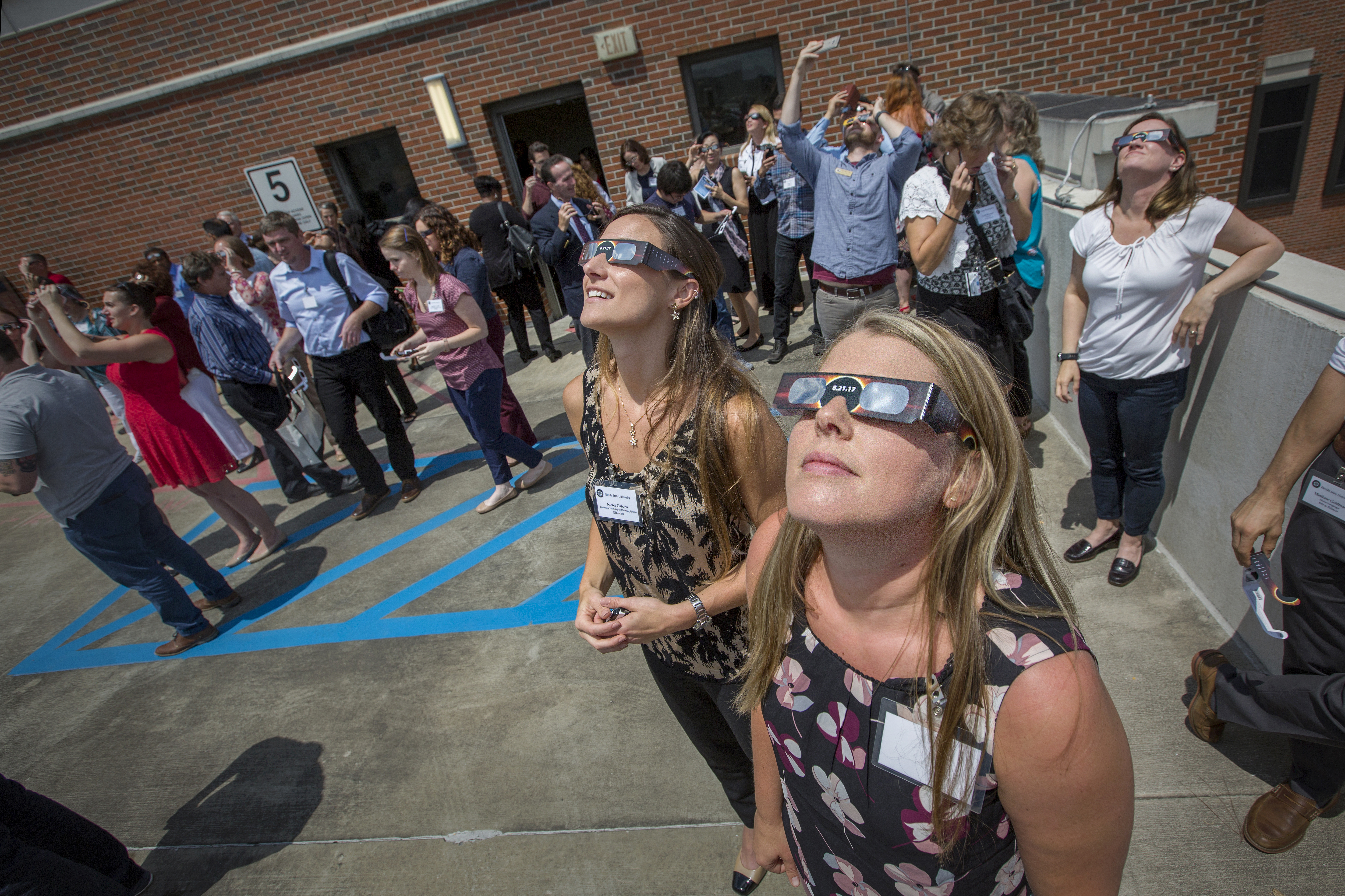 Photo of faculty viewing the eclipse